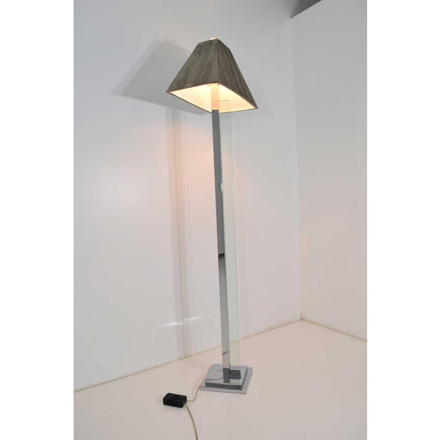 Unique chrome and glass floor lamp with heavy painted shade. Shade can be replaced.