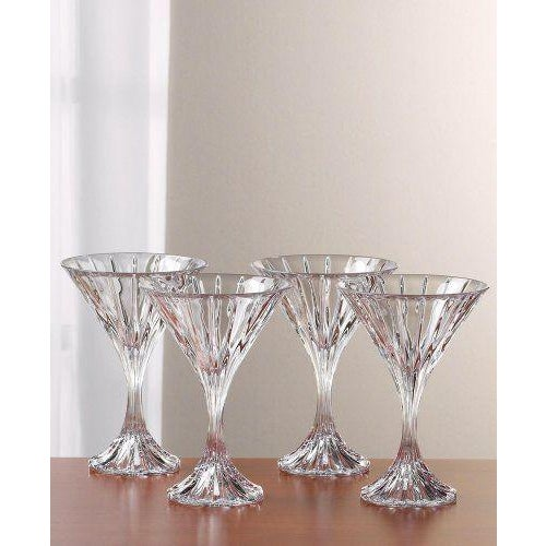 """A set of Mikasa """"Park Lane"""" crystal martini glasses. This set is complete with four martini glasses. They are marked on..."""