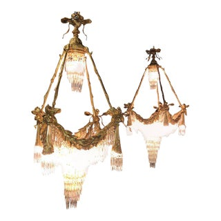 Doré Bronze Louis XVI Style Crystal Ribbon Tassel Drapery Chandeliers - A Pair For Sale