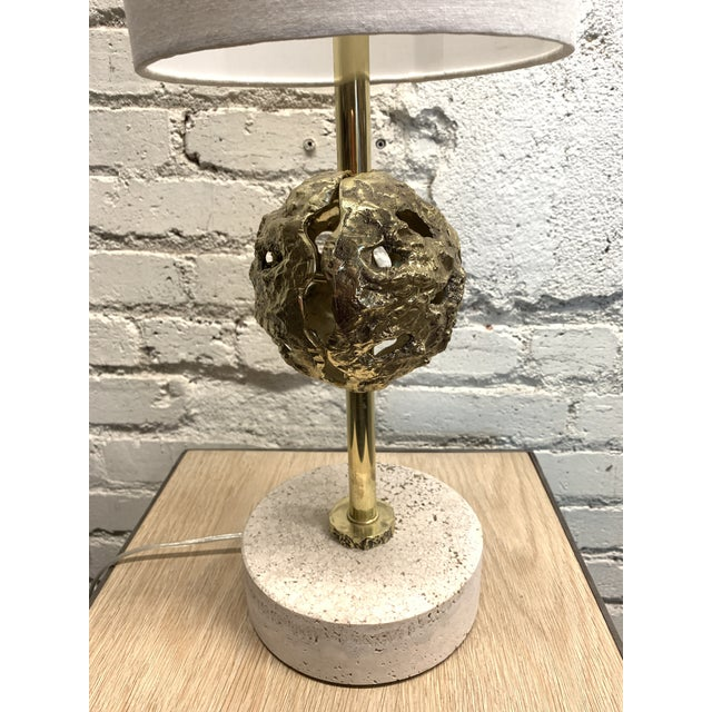 Pristine pair of designer mid century lamps on travertine marble bases with original shades.
