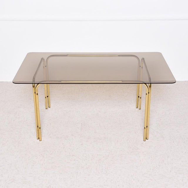 Smoked glass and brass, a match made in mid-century heaven. Let this groovy dining table speak for itself.
