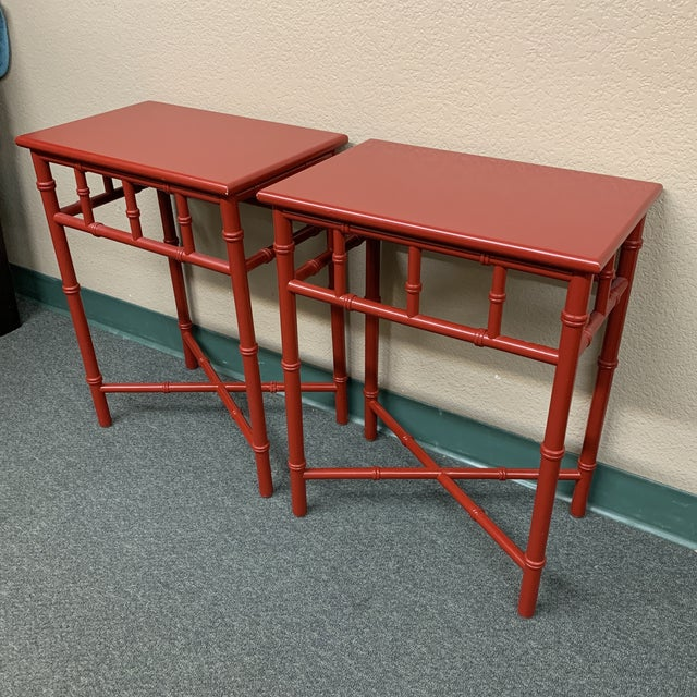 Design Plus Gallery presents a pair Mid-20th Century Red Faux Bamboo Accent Tables. Bamboo is constructed in a trellis...