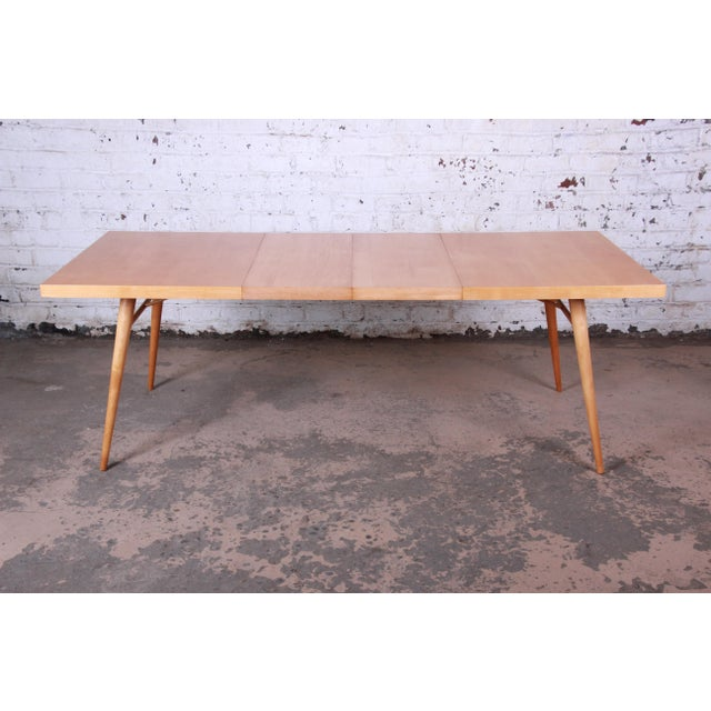 Offering an exceptional mid-century modern extension dining table designed by Paul McCobb for his Planner Group line for...