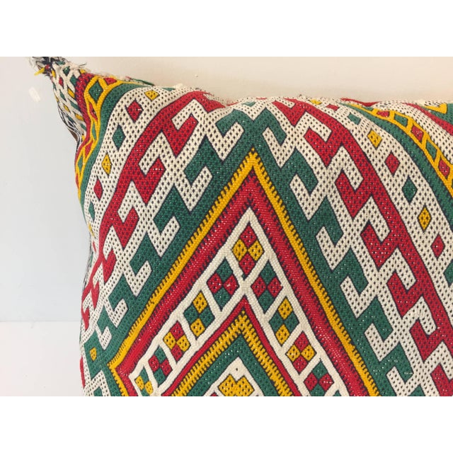Moroccan Berber pillow red with geometric tribal designs. Handwoven tribal throw pillow made from a vintage flat-weave...