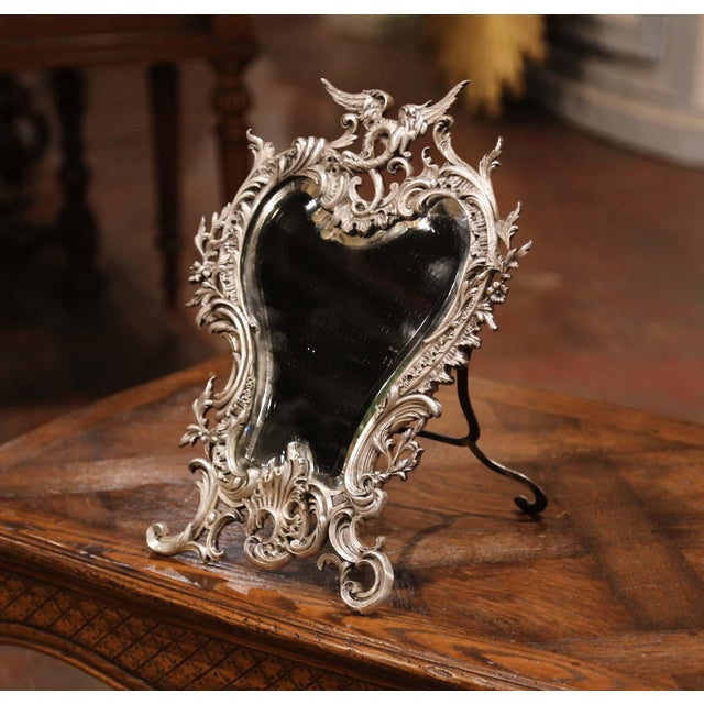 Decorate your master bath counter with this elegant antique silvered dressing mirror. Crafted in France circa 1870, the...