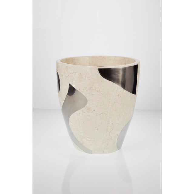 """Medium 10 1/4"""" planter executed in fiberglass and fully inlaid with white ivory stone and stainless steel in a fun..."""