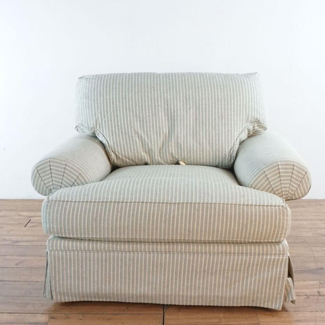 """Club chairs with rolled arms and down filled cushions and pillows. Skirted upholstery is """"Long Beach"""". Brand is Michael..."""