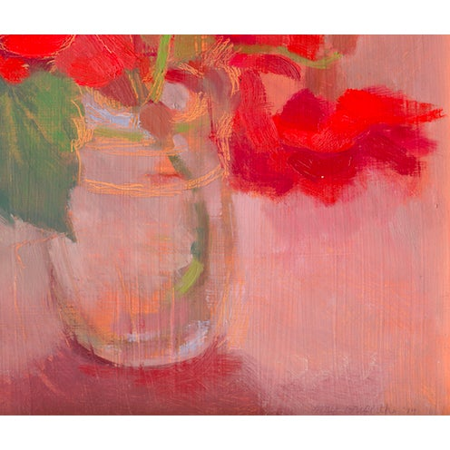 Vermillion Begonias in a clear vase.