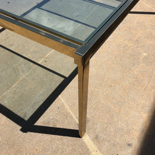 Absolutely gorgeous and stylish brass dining table with two leaves that fold out and tuck in for compact dining. Authentic...
