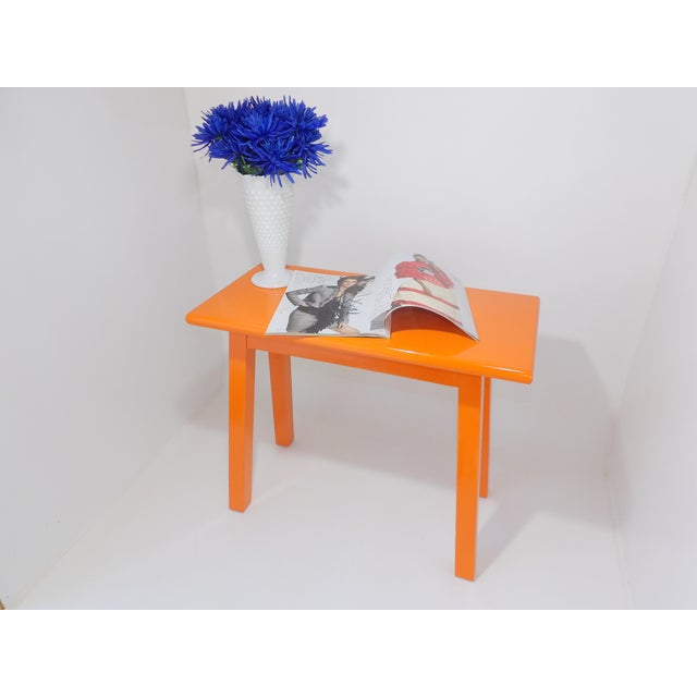 This is a gorgeous mid-century modern table that has been painted a gloss orange. Beautiful sturdy table! Can be used as...