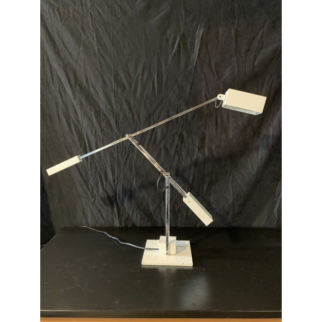 Uncommon articulating, counter-weighted desk lamp designed by Robert Sonneman. Great piece in perfect working order in...
