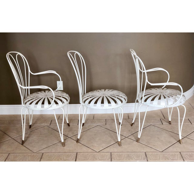 We are very pleased to offer a stunning set of three French art deco sunburst garden chairs attributed to Francois Carre,...