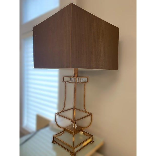 A beautiful table lamp made of iron giving it excellent durability and strength. This lighting feature provides a...