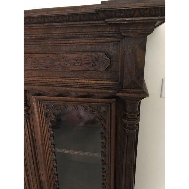 Beautiful detail on this Antique French Bookcase. 3 Glass doors open to 3 full length shelves. Heavy oak to pass on for...