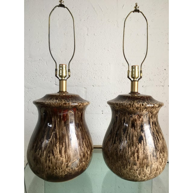 A pair of Vintage Mid Century Modern Ceramic Table Lamps form the 1960's These lamps feature a unique very clean lines and...