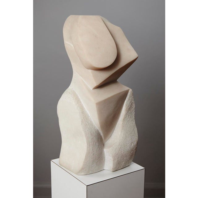 Large, Portuguese pink marble sculpture showing an abstract version of a woman's torso. A modern 20th century...