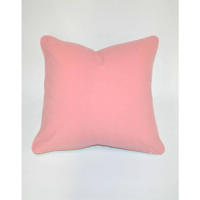 "A bright, pink, multi-colored, 20"" x 20"" pillow in cotton linen with a solid pink back; contrasting in pink welting; fully..."