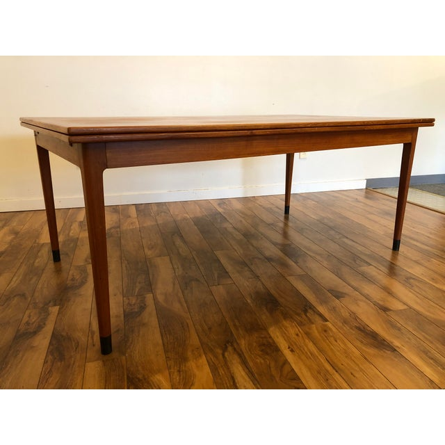 Large Danish teak draw leaf dining table by Niels Otto Møller for JL Møller. The table is large enough to seat eight...