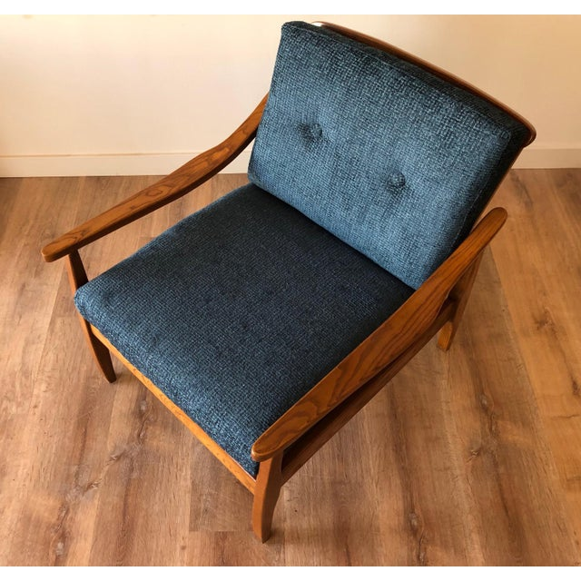 Newly upholstered with new cushions and tufted buttons on seat back cushion. Restored with new seat webbing. Solid...