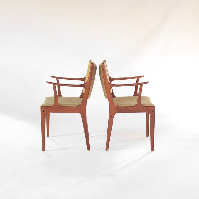 Presenting this lovely pair of Johannes Andersen for Uldum Møbelfabrik Teak Dining Armchairs. Starting off is the...