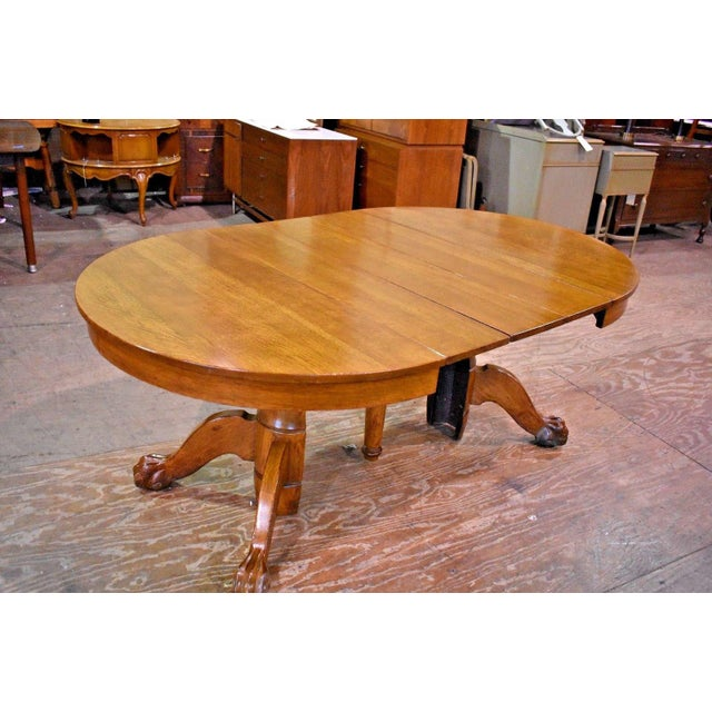 f085b3756325 Versatile Round Quarter Sawn Oak Table with Paw Feet on casters.   3
