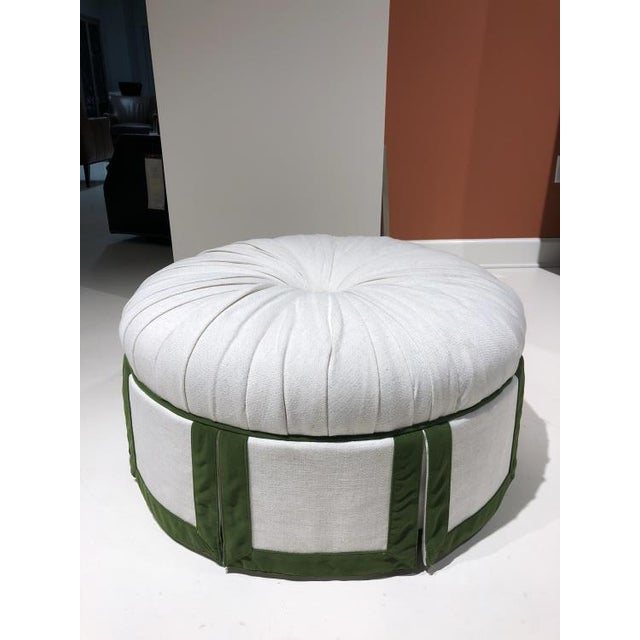 The Margaret Ottoman is a first quality market sample that features a green and white fabric.