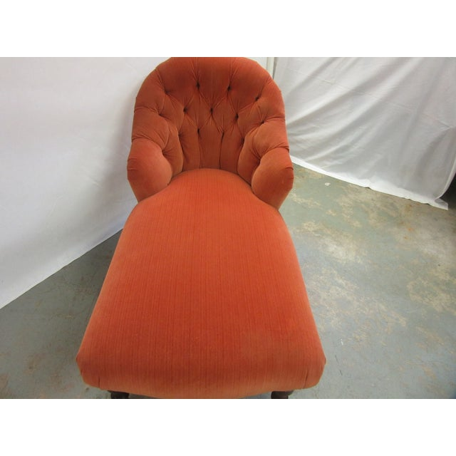 High quality Hancock and Moore chaise with orange velvet upholstery. Back of seat is tufted. Legs are wood. Some fading to...