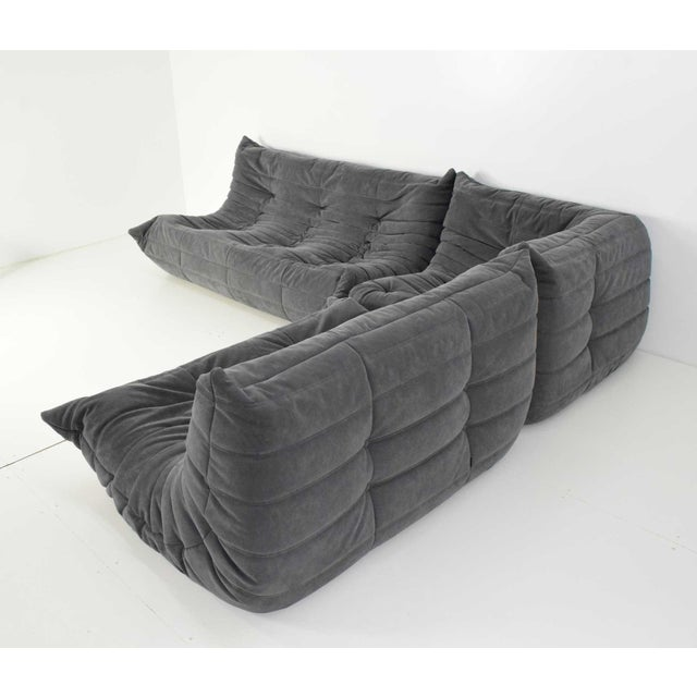 superb ligne roset togo sofa in grey suede by michel ducaroy decaso. Black Bedroom Furniture Sets. Home Design Ideas