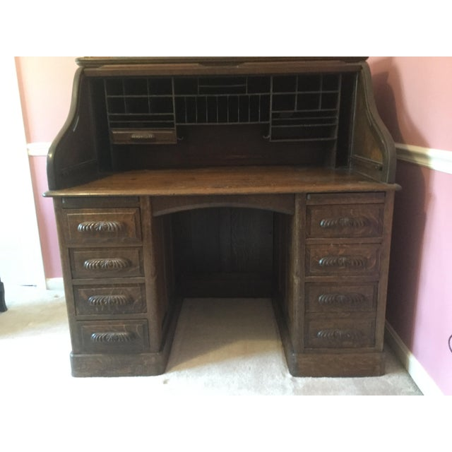 Antique solid wood roll top desk. 6 regular side drawers and one file size bottom drawer. There is also 2 pullouts one on...