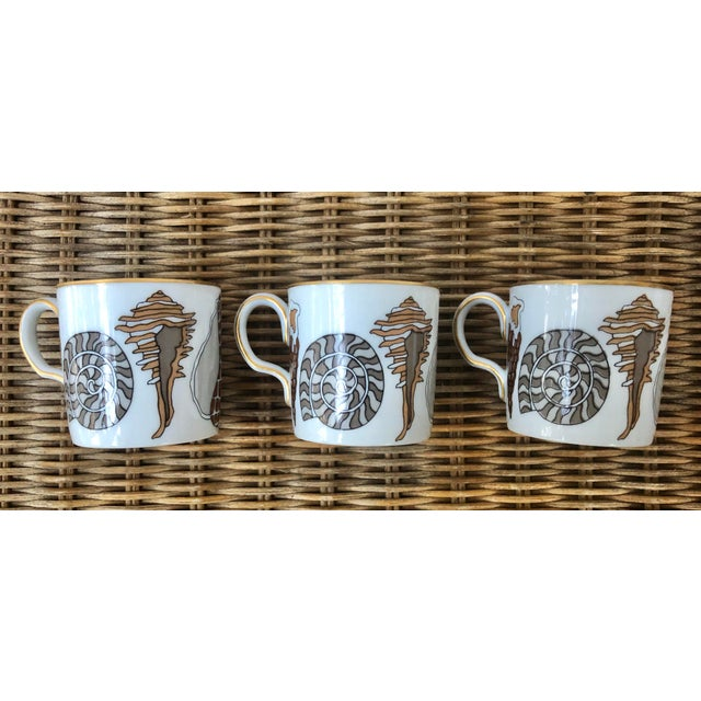 """A set of 3 gilt-rimmed porcelain demitasse or espresso cups. These were """"made expressly for Neiman Marcus"""" by Fitz and..."""