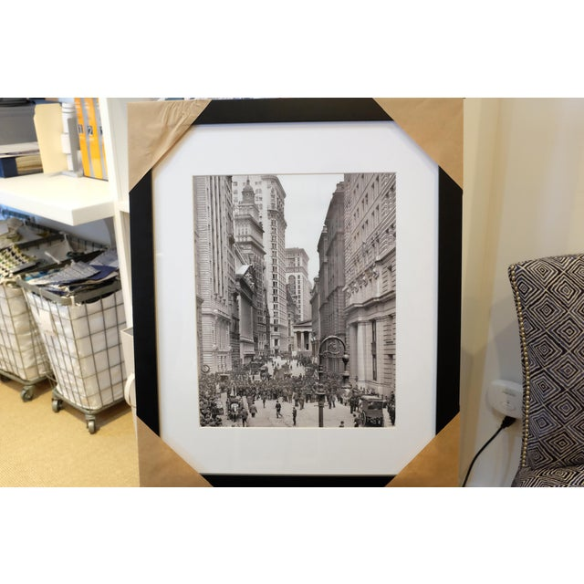 Framed and matted black & white photograph of urban cityscape and architecture. Back is covered in a brown paper. No...