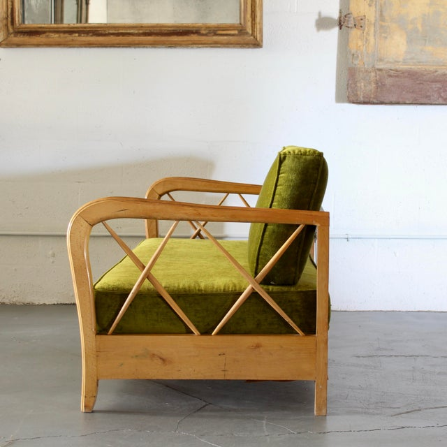 Paolo Buffa style mid-century maple sofa daybed ca. 1960. The arm rails fold down, and the back reclines for total...