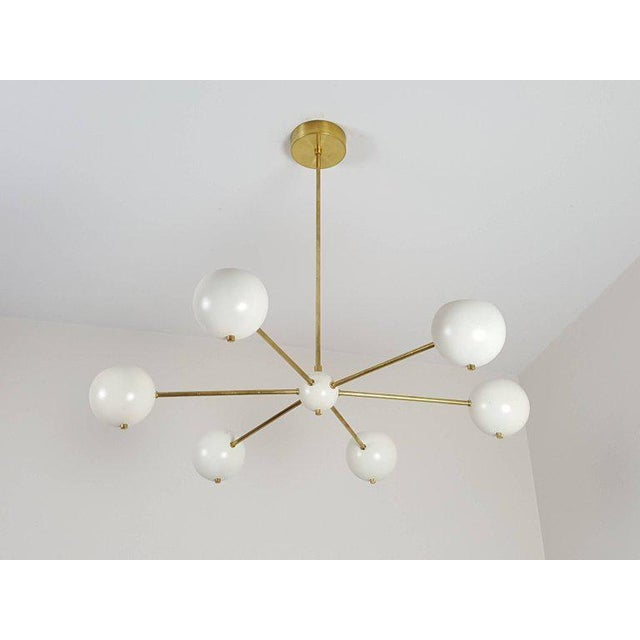 Introducing the Model 320, a chic, simple brass chandelier with enameled spun aluminum orbs by Blue Print Lighting, 2017....