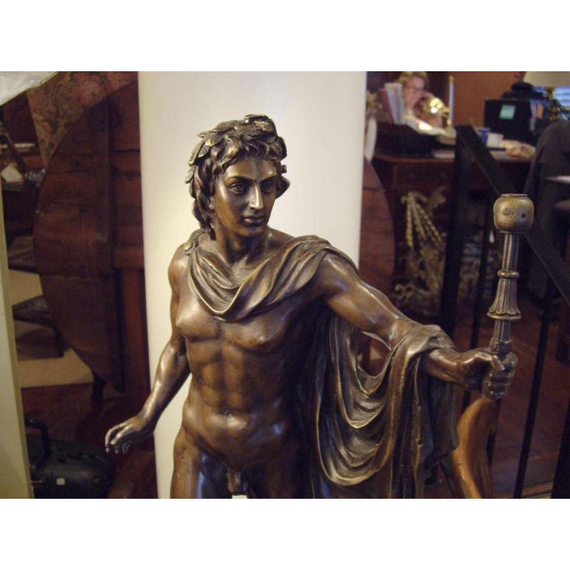 Italian bronze statue of classical male nude on black marble base. Marble base is 7 1/2″ X 7 1/4″. Circa: Late 19th Century.