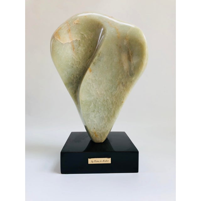 Intriguing from all angles, large Mid-Century Modern polished green marble biomorphic sculpture with veining supported by...