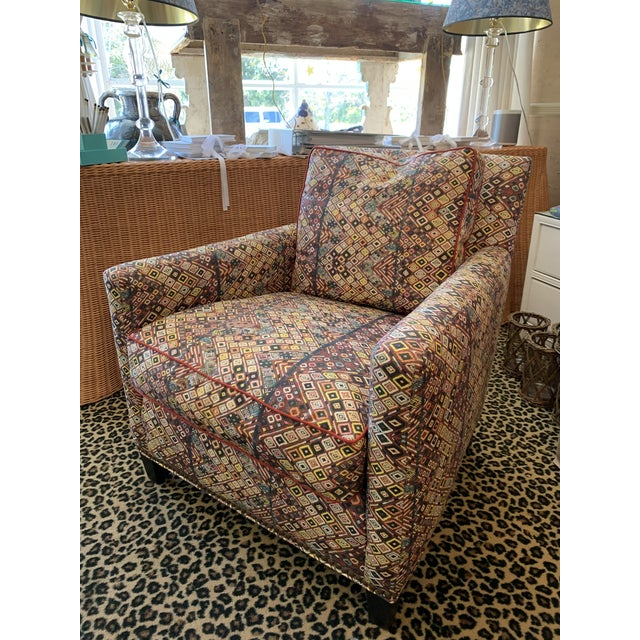 Custom club chair in St Frank fabric with nailhead trim. Pair available.