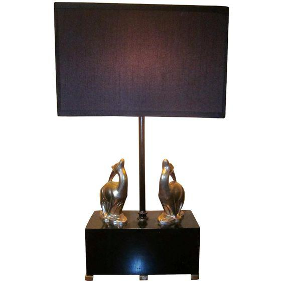 This is a graceful and collectible 1920s-1930s art deco figural table lamp or accent lamp, in a classic machine-age black...