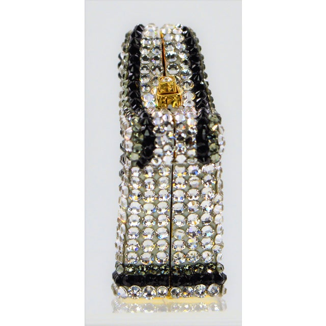 """Harp shaped pillbox covered in Swarovski crystals by Judith Leiber Approximate Dimensions: 1-3/4"""" x 3/4"""" x1.125 Signed on..."""