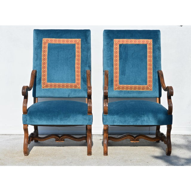 """A pair of Louis XIV style armchairs in the """"Os de Mouton"""" taste and construction. Dressed in a vibrant peacock velvet..."""