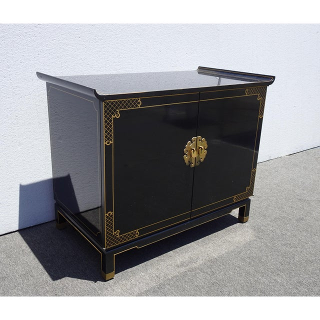 Gorgeous Cabinet in Good Vintage Condition. Solid and Firm. There are many light scratches on the Table Top. Otherwise,...