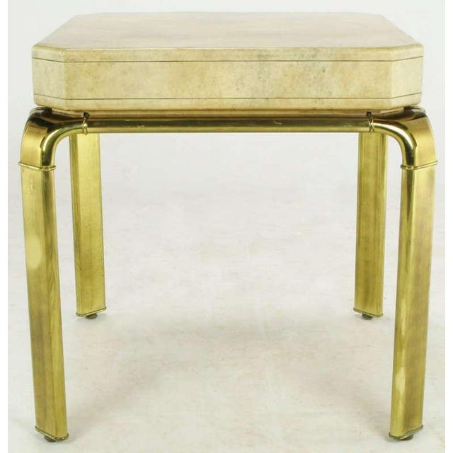 An unusual end table design from John Widdicomb, this lacquered goatskin finish case is mounted atop a patinated brass,...