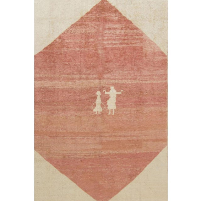 Hand-knotted vintage circa 1960 Gabbeh rug with thin pile in soft shades of red and ivory with motif of people and animals.