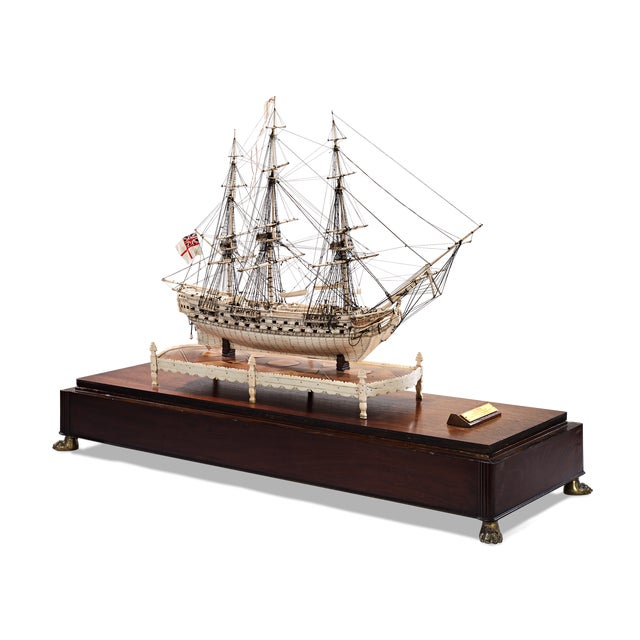 Incredibly rare and stunningly beautiful, this intricately carved ship model was created by a French prisoner during the...