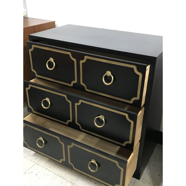 Stunning and fabulous Hollywood regency/ mid century modern chest in the Dorothy Draper style. Piece features a black...