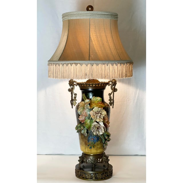 This Impressive Over-Scale lamp features dramatic ceramic three-dimensional flowers and buds in pleasing tones of pinks,...