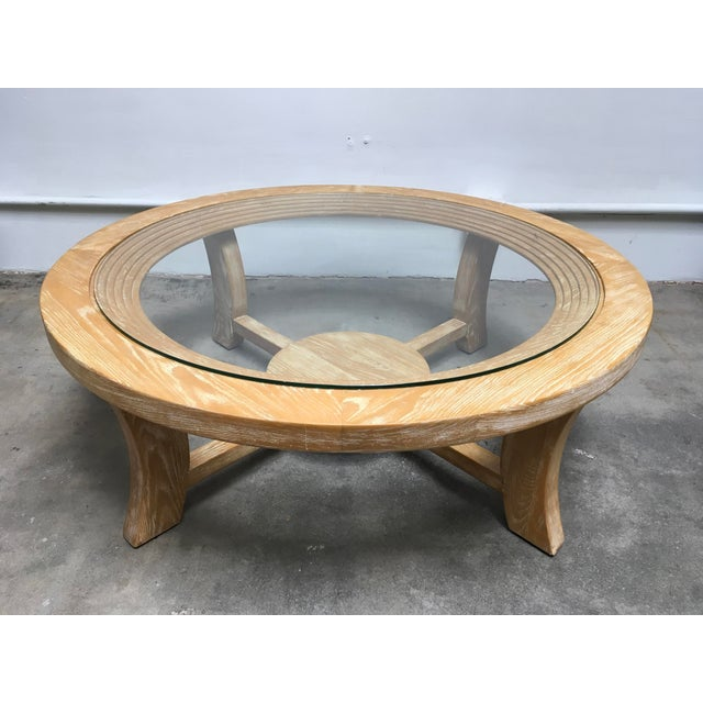 Famous Paul Frankl for Brown Saltman round coffee table with glass top. The solid oak wood has been professionally Cerused...