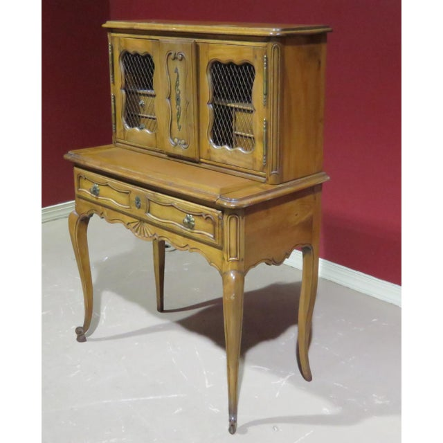 19thC Country French writing desk with 2 doors containing 4 drawers over a pull out writing surface and one drawer.