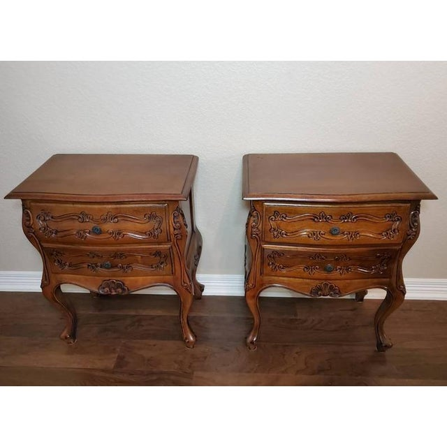 A wonderful pair of vintage Louis XV Rocaille style hand carved walnut beside cabinets from the mid 20th century....