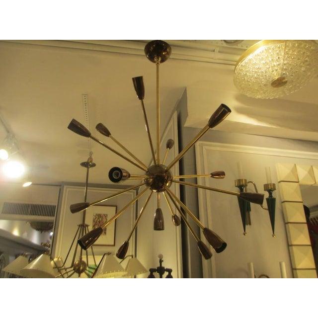 Custom brass and copper sputnik chandelier with 14 arms.
