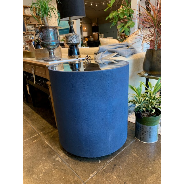 Contemporary blue faux shagreen barrel end table with mirror top. 2 available for purchase